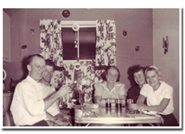 Reds and Anne Baker with family friends, circa 1954